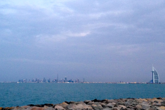on the man-made island of The Palm, looking back towards Dubai, with Burj Al Arab on the right and the Kalifa barely visible.