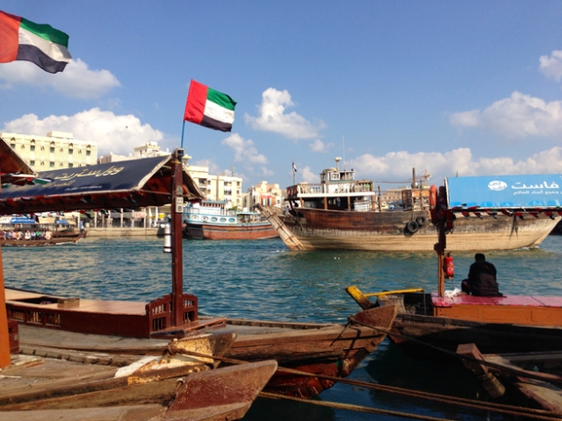 down at creekside by the water taxis as a typical dhow passes