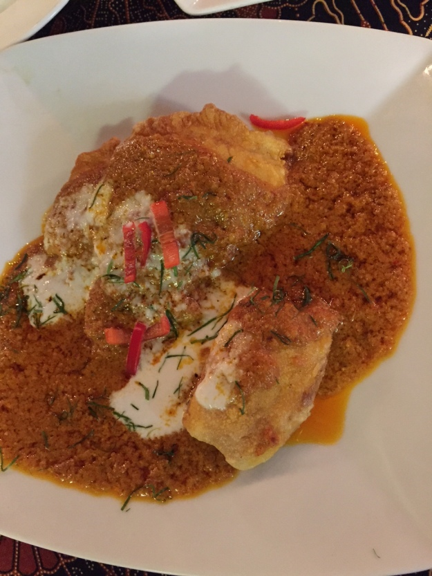 a most excellent fish in yellow curry sauce