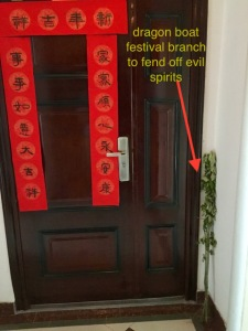 the temporary branch drives out evil, but the red banners are always there, spouting happy new year, good luck and health and other superstitious babble.