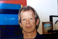age 50 in front of painting from Mauritius