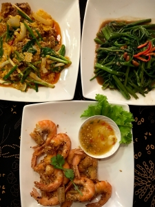 one of my goto dishes at Suk 11, stir fried morning glory, soft shell crab in yellow curry, and fried shrimp.
