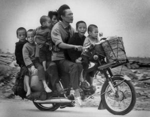 South Vietnamese parents, with their five children, ride along Highway 13, fleeing southwards from An Loc toward Saigon on June 19, 1972. (AP Photo/Nick Ut)